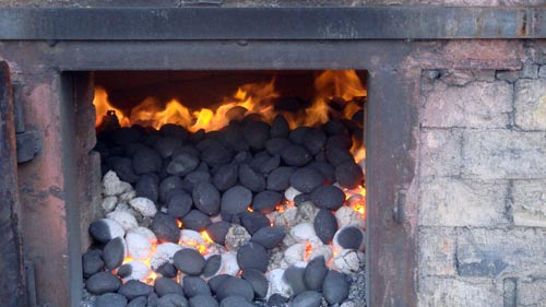 Burning Coal Briquettes